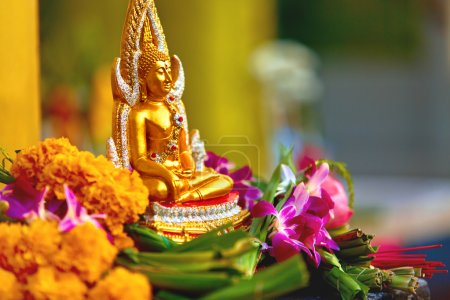Religion. Buddha Statue With Flowers At Temple, Thailand. Buddhi
