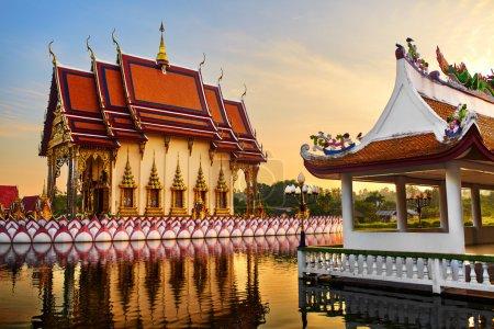 Photo for Thailand Landmark. Scenic View Of Buddhist Pagoda At Sunset. Temple Complex Wat Phra Yai ( Wat Plai Laem ), Big Buddha Temple At Koh Samui. Travel, Tourism. Oriental Architecture. Landscape Background - Royalty Free Image