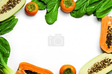 Photo for Food Background. Healthy Fresh Raw Organic Fruits And Vegetables. Pak Choi ( Bok Choy ), Papaya, Green Salad, Persimmon On White Background. Vegetarian Nutrition. Diet And Vitamins Concept - Royalty Free Image