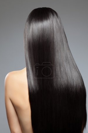 Woman with long straight shiny hair