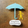 Paper person under an umbrella with Long Term Care...