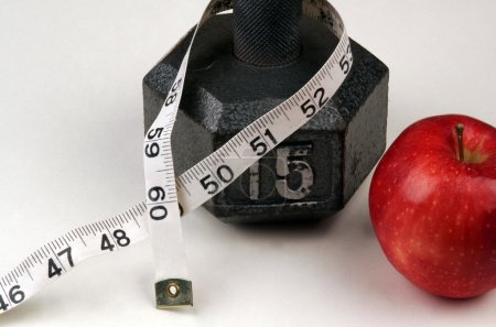 Dumbbell and measuring  tape