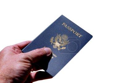 Hand holding an American Passport