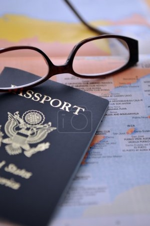 Passport and Glasses on the atlas