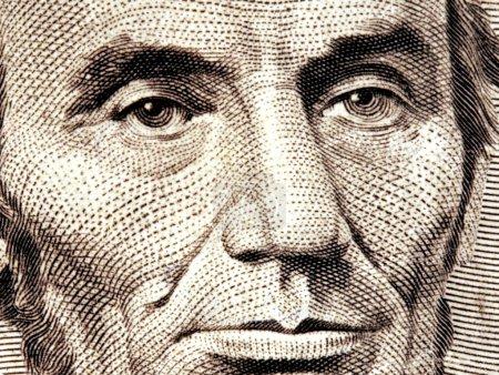 Photo pour Abraham Lincoln sur un billet de cinq dollars - image libre de droit