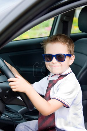 Photo for Cute barefoot driver in car in summer - Royalty Free Image