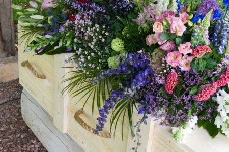 Coffin with flower arrangement