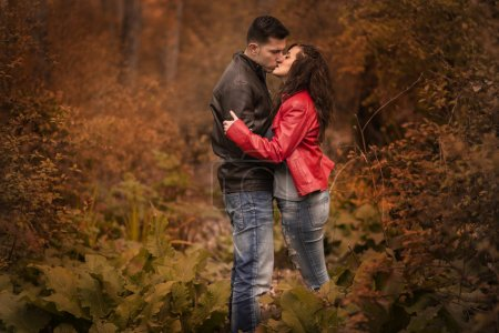 Photo for Couple kissing outdoor in the park, Autumn - Royalty Free Image