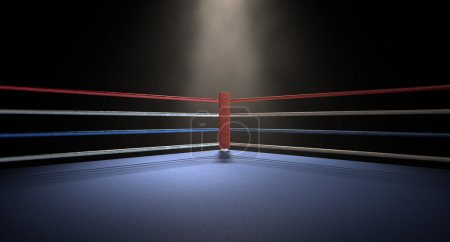 Photo pour Un gros plan du coin rouge d'un anneau de boxe régulier entouré de cordes éclairées par un projecteur sur un fond sombre isolé - image libre de droit