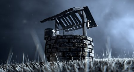 Photo pour Une vue imprenable sur un puits d'eau en brique avec un toit en bois et un seau attaché à une corde dans une prairie herbeuse éclairée par une lune en début de soirée sur un fond sombre - image libre de droit