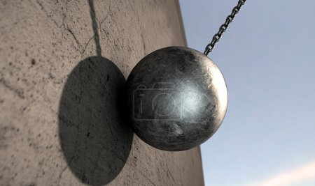 Photo for A regular metal wrecking ball attached to a chain hitting a concrete surface - Royalty Free Image