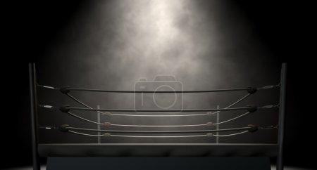 Photo pour Un vieil anneau de boxe vintage entouré de cordes éclairées au milieu sur un fond sombre isolé - image libre de droit