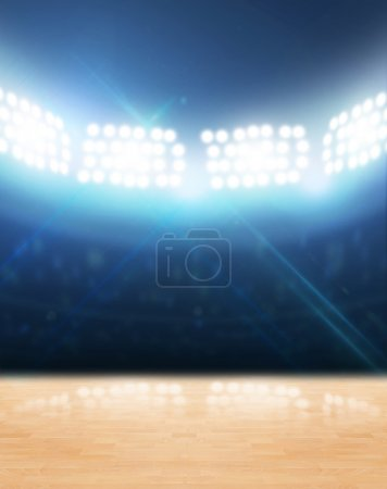 Photo for An indoor gynasium with an unmarked wooden floor under illuminated floodlights - Royalty Free Image