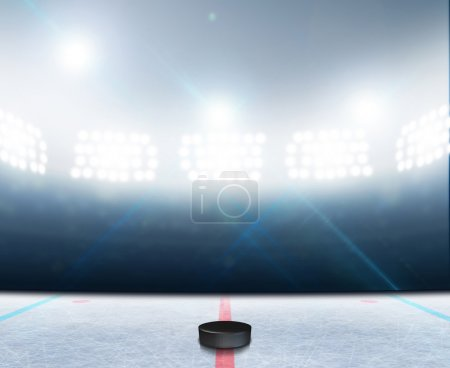 Photo for A generic ice hockey ice rink stadium with a frozen surface and a hockey puck under illuminated floodlights - Royalty Free Image