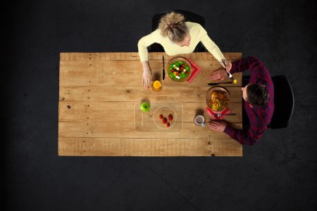 Top view of couple at table with food
