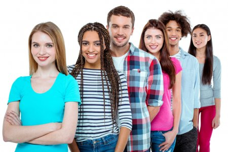 Photo for Studio shot of nice young multicultural friends. Beautiful people standing in a row, looking at camera and smiling. Isolated background - Royalty Free Image
