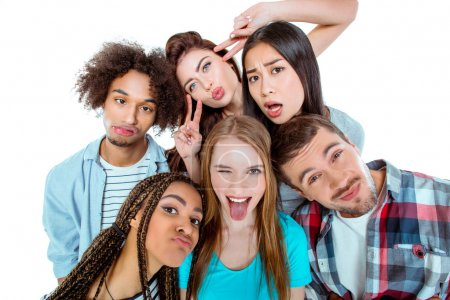 Photo for Studio shot of nice young multicultural friends. Beautiful people having fun while making faces at camera. Isolated background - Royalty Free Image