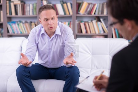 Man talking to his psychologist