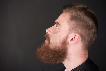 Stylish man with beard looking up