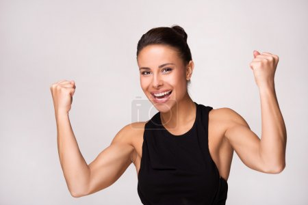 Close up of mixed race woman gains victory