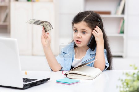Girl playing role of business woman