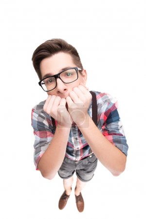 Photo for Stressed boy with eyeglasses biting fingernails, isolated on white background - Royalty Free Image