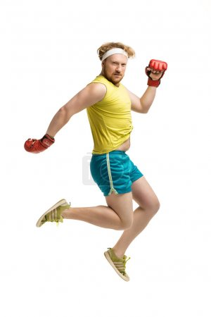 Photo for Funny picture of red haired, bearded, plump man on white background. Man wearing sportswear and red boxing gloves - Royalty Free Image