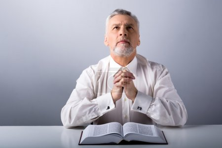 Photo for Photo of old man praying to God with Bible and looking up - Royalty Free Image