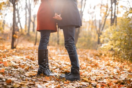 Photo for Close up romantic photo of cute couple outdoors in fall. Young man and woman standing in leaves - Royalty Free Image