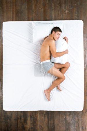 Top view photo of sleeping man