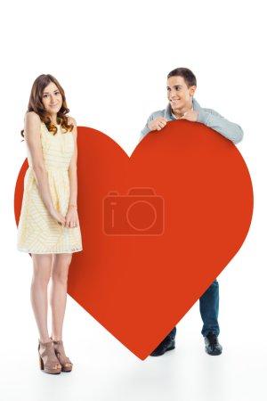 Couple near big red heart