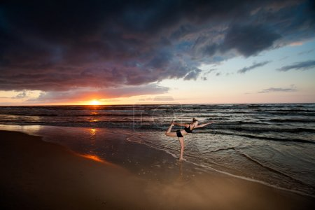 Summer yoga session on a beautiful golden beach - ...