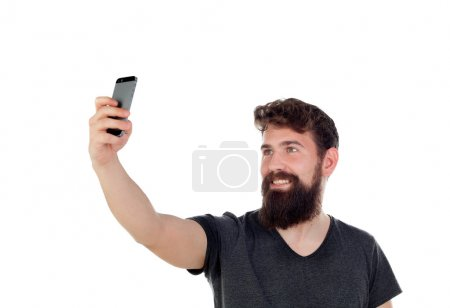 Handsome man taking selfie with mobile phone