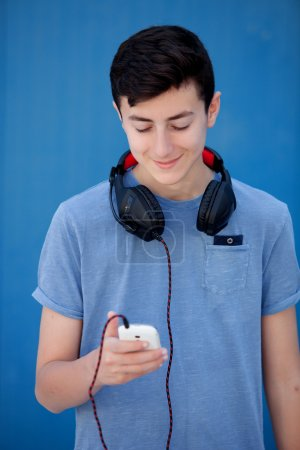 Teen listening to music with headphones