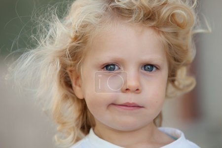 Photo for Beautiful boy three year old with long blond hair on a sunny day - Royalty Free Image