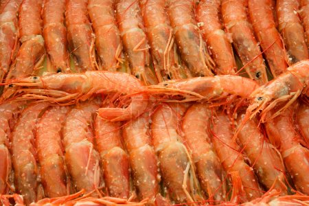Tray of shrimps doused in sauce