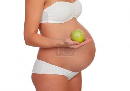 Body pregnant in underwear with a green apple