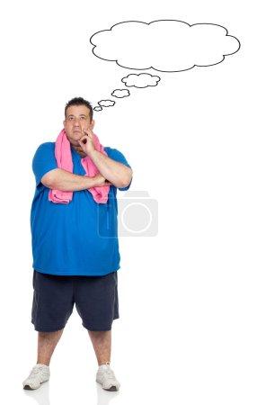 Pensive fat man with sportswear