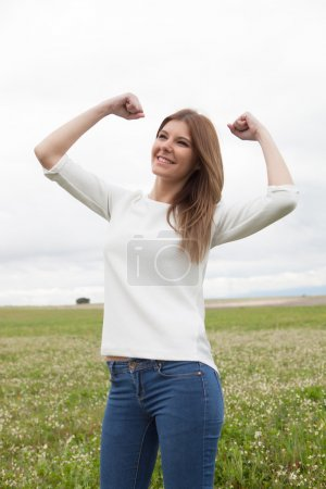 Girl in the meadow celebrating the success