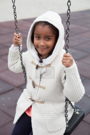 Black girl playing with a swing