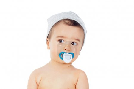 Little boy with pacifier in mouth