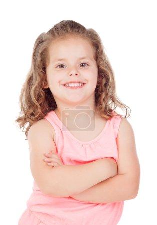Photo pour Petite fille mignonne souriante et posant à la caméra, isolée sur fond blanc - image libre de droit