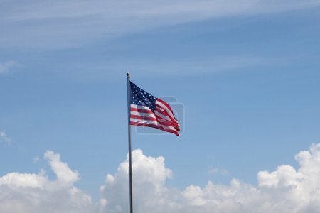Photo for Flag of United States of America waving in the mast with blue sky backgroun - Royalty Free Image