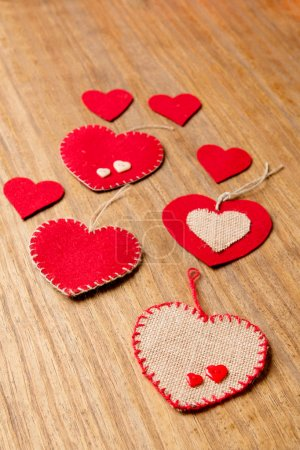 Valentine hearts on wooden background