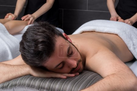 Young man at massage session in spa.