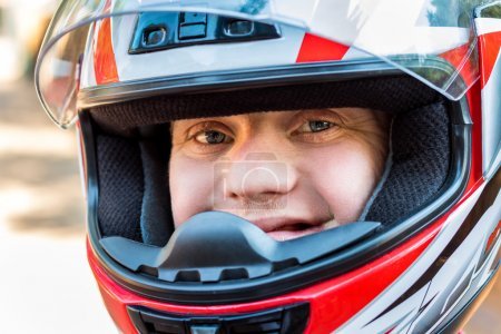 Photo for Close up face shot of young sportsman with down syndrome wearing helmet. - Royalty Free Image