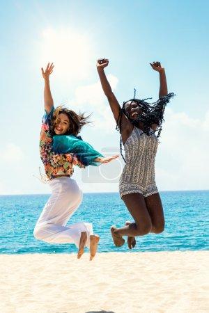 Diversity teens jumping on beach