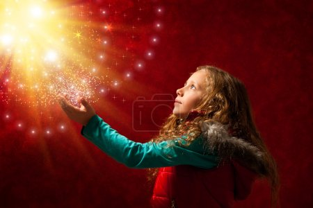 Young girl touching stars.