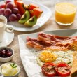 Close up of english breakfast with fresh fruit and...