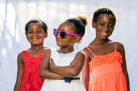 African girl wearing fun sunglasses.
